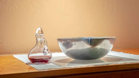Panorama frame Red wine and bowl of wafers for Communion Stock Photo