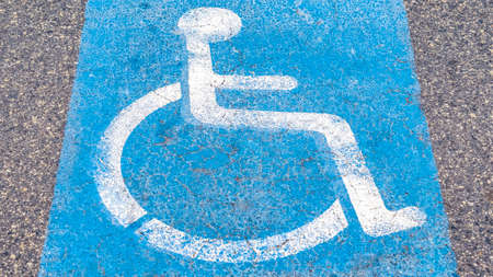 Panorama Disabled or Handicapped road sign painted on asphalt in a restricted area for wheelchair access