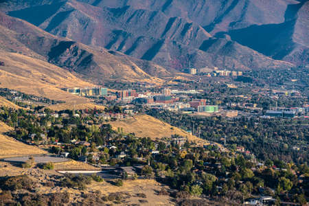 Overview of the suburbs of Salt Lake City in the Utah Valley with imposing mountain backdrop