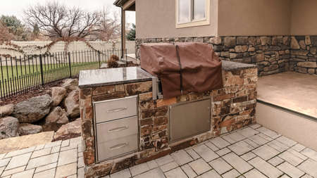 Panorama frame Covered stone outdoor kitchen on a paved patio Stok Fotoğraf