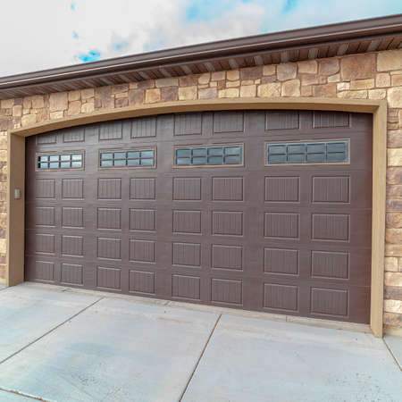 Square frame Large closed double wooden garage door day light Imagens