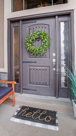 Vertical Beautiful home entrance with gray door sidelights and huge transom window