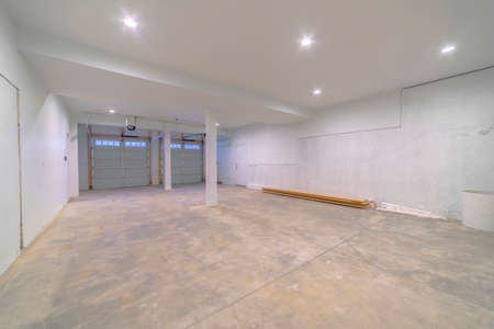 Large white clean empty garage for cars