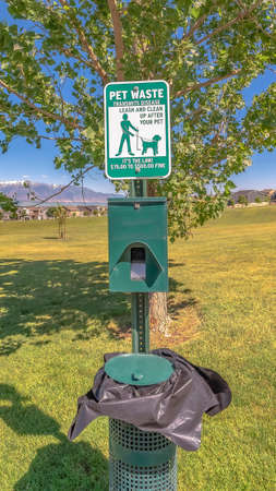 Vertical frame Dog poop bags and garbage can against timpanogos mountains and blue lake