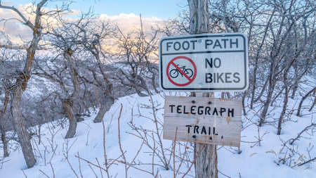 Panorama frame Signages at the Telegraph Trail of Wasatch Mountains buried in snow in winter. Residential community and steep peak can be seen in the distance. Zdjęcie Seryjne