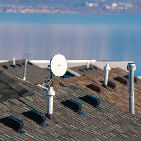 Square frame Television satellite dish mounted on a roof