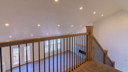 Panorama crop View through the wooden banisters of a staircase in an apartment block or house