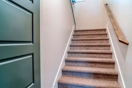 Staircase that goes up from the garage or basement to the main floor of home