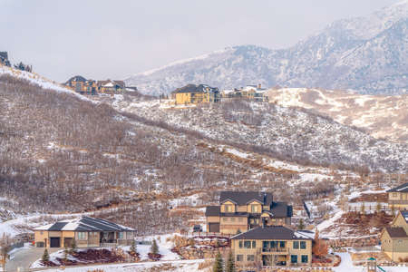 Residential community on the gentle mountain slopes dusted with snow in winter