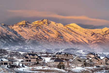 Homes in Utah Valley with view of magnificent Wasatch Mountains at sunset