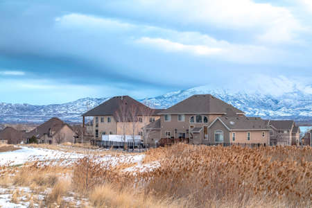 Homes in Utah Valley on a scenic winter scene with Wasatch Mountains background