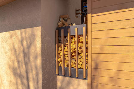 Stack of firewood in an alcove between exterior walls of a home in Park City 스톡 콘텐츠