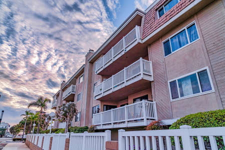 Apartments with private balconies and view of the street in Huntington Beach CA