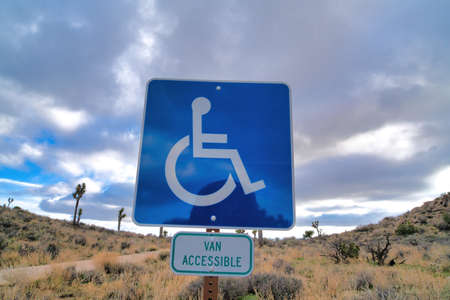 Handicapped parking and van accessible sign against Joshua Tree National Park Zdjęcie Seryjne