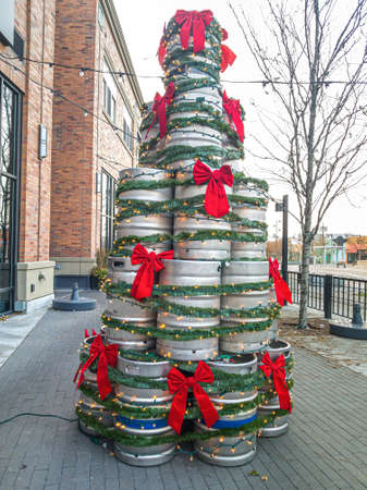 Christmas tree made of upcycled metal drums on the street in front of buildings