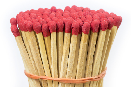 matches and matchbox on a white background