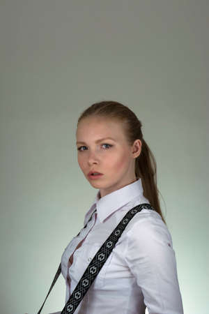 suspenders: girl in a white shirt and suspenders Stock Photo