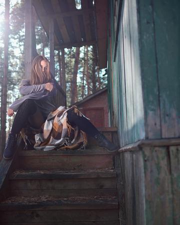Brunette posing on the veranda in the autumn. autumn casual. Autumn fashion  model. Stock Photo