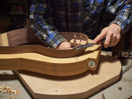 The process of making a classical guitar. Giving the sides of the guitar the right shape.