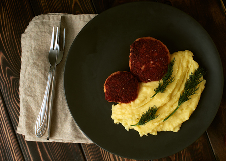 Cutlets from salmon with mashed potatoes.