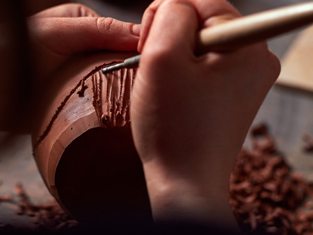 production process of pottery. applying a texture on the pottery.