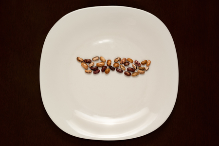 plate with beans in the shape of a mustache