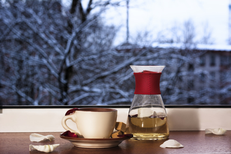 Mug with tea on a background of a winter landscape. tea ceremony.