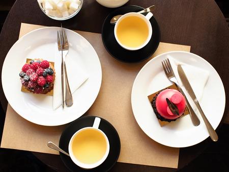 Dessert in the cafe, Crimson and raspberry-pistachio cake.