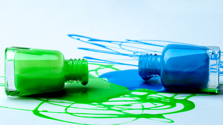 spray of green and blue nail polish on white paper. Reklamní fotografie