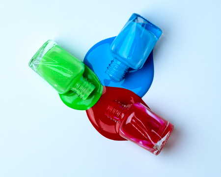 Spilled green, blue and red nail polish.