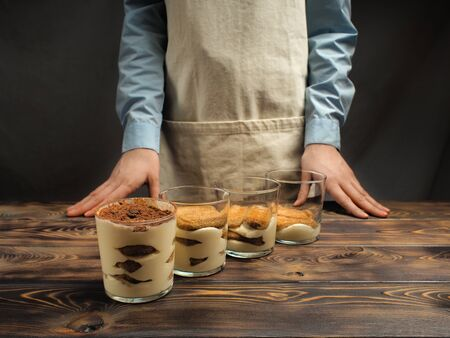 Recipe of preparation of a dessert of tiramisu, seventh part: Filling of cups by a dessert.