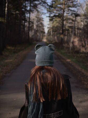 Woman on the road. Autumn Walk. autumn mood.