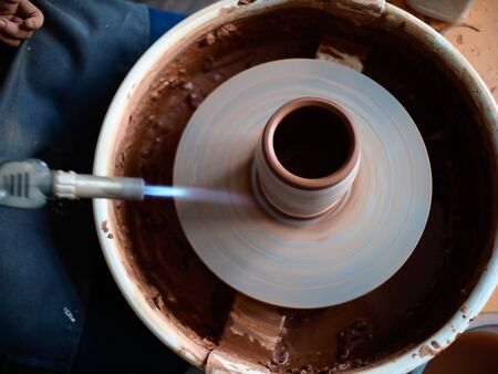 production process of pottery. Firing the glaze for the appearance of cracks. Stok Fotoğraf