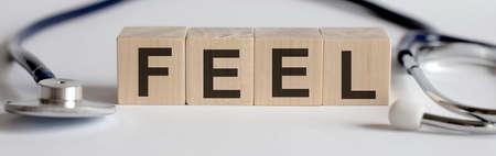 FEEL medicine word written on wood block with