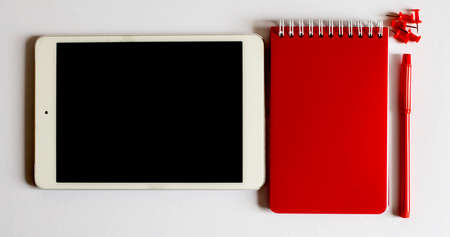 Office red tools. Digital technology. Innovative implementation in business. Wireless function. The tablet and office tools.
