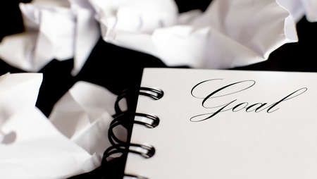 Business Words on notepad, business tex Goal on black background
