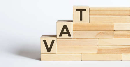 Work strategy on the wood blocks VAT on the white background. Business