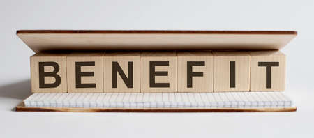 Innovation word wood block Benefit on table for business concept.