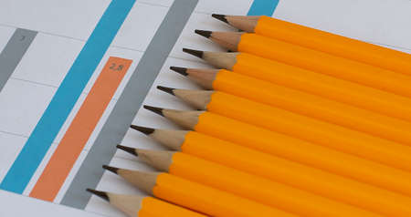 Yellow pencil on chart background. Business