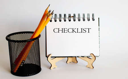 Notepad and text Checklist and yellow pencil. Business