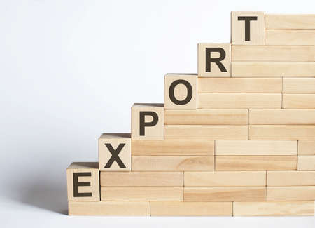 EXPORT Word Written In Wooden Blocks on the white background