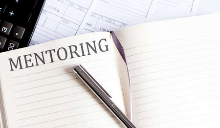 Notebook with Toolls and Notes about MENTORING. Business