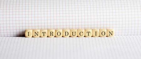 Concept INTRODUCTION Words written on wooden block on notebook. Leadership concept. Standard-Bild