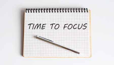 TIME TO FOCUS text written on notebook with pen