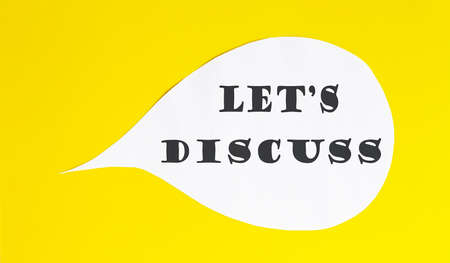 LET'S DISCUSS speech bubble isolated on the yellow background. Business concept Foto de archivo