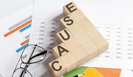 CAUSE words with wooden blocks on chart background. Business concept.