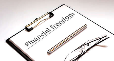 Financial Freedom Concept on the white sheet with pen and glasses 版權商用圖片