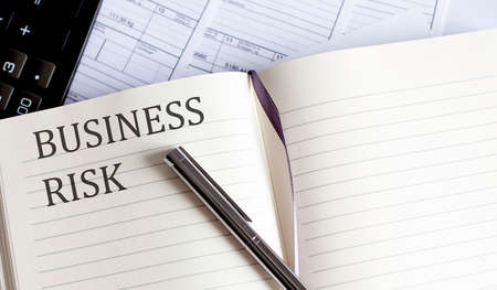 Notebook with Toolls, charts and Notes about BUSINESS RISK
