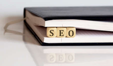 cubes with SEO search engine optimization in notepad Stock Photo