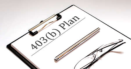 Document with 403b plan with pen and glasses .Retirement concept.